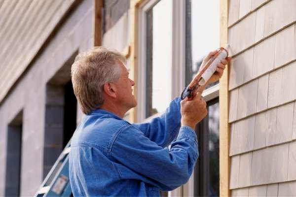 Home inspector caulking a window in south carolina