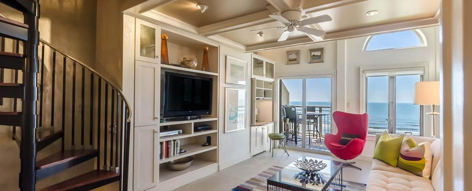 Condo - Living Area - Spiral Stairs - Porch in background with view to beach