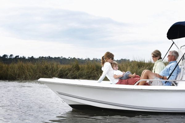 Family including boy (15-18 months) relaxing on boat in South Carolina