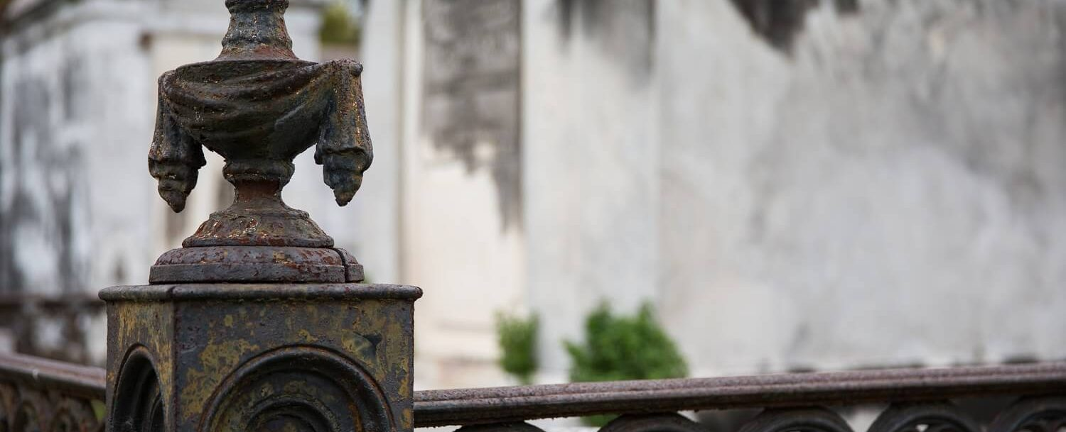 a cemetery post at a graveyard on a Charleston, SC, ghost tour