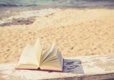 relaxing at the beach with a book