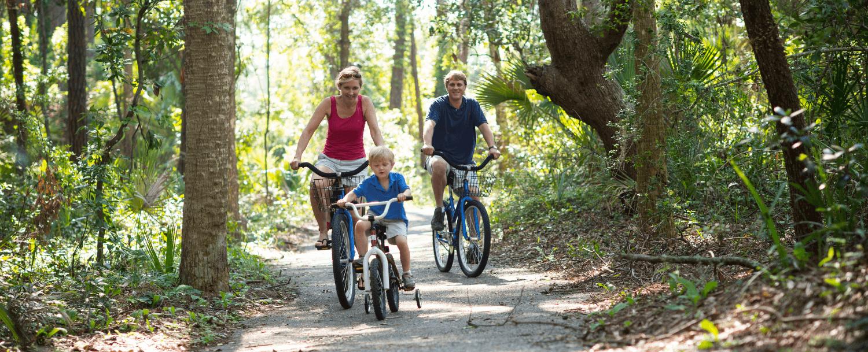 Family Riding Bikes in Night Heron Park