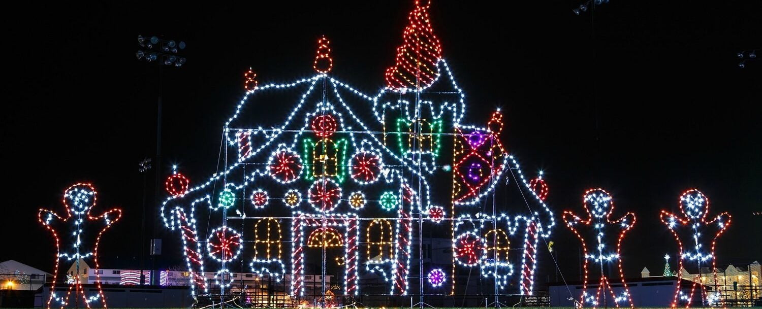 house and gingerbread men made of Christmas lights