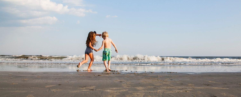 Family on beach near charleston